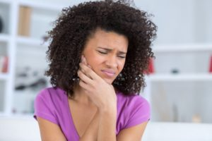 woman with toothache who needs emergency dentist in Moses Lake