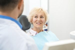 Older woman smiling at dentist