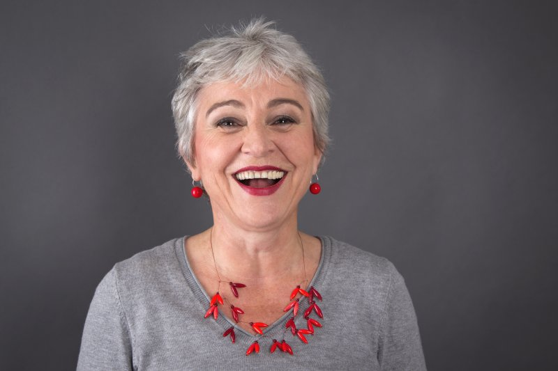 Woman with dental implants in Moses Lake laughing